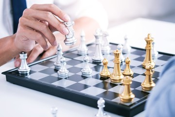 Businessman play with chess game. success management concept of business strategy and tactic...