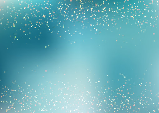 Abstract falling golden glitter lights texture on blue turquoise background with lighting. Magic gold dust and glare. Festive Christmas background.
