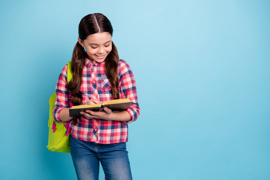 Portrait of her she nice attractive smart clever cheerful girl nerd wearing checked shirt library visitor learning materials poem science isolated on bright vivid shine blue turquoise background
