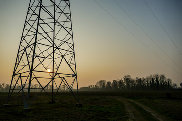 electricity pylons at sunset, digital photo picture as a background