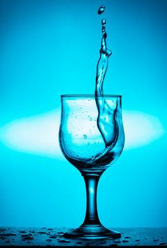 Splash of wine or water in a glass. Splash in a glass of wine. Art photo.