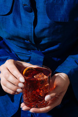 Negroni cocktail, with gin, bitter, vermut, in pop contemporary style, colorful and trendy