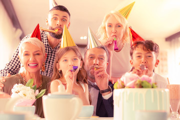 Beaming happy family having much fun celebrating birthday