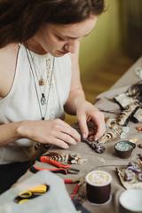 Artisan woman making handmade gemstone jewelry