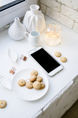 Flat lay top view arrangement with empty screen smartphone and home decor
