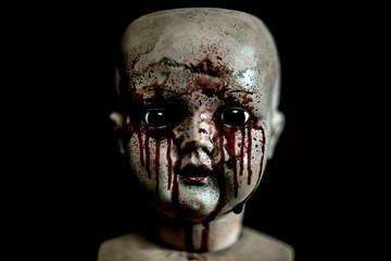 Creepy bloody doll in the dark