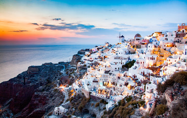 amazing view of Oia town at sunset in Santorini, Cyclades islands Greece - amazing travel destination