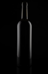 Black matt glass wine bottle, isolated on black