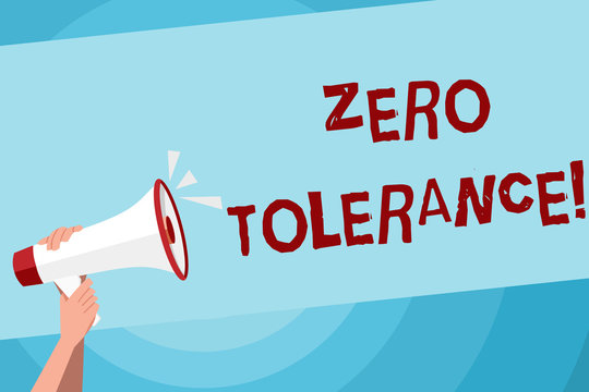 Text sign showing Zero Tolerance. Business photo text refusal to accept antisocial behaviour or improper behaviour Human Hand Holding Tightly a Megaphone with Sound Icon and Blank Text Space
