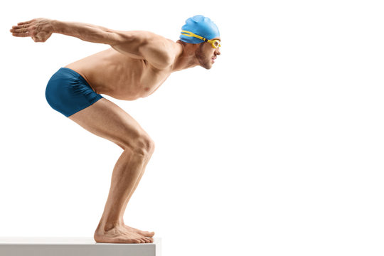 Fit male swimmer waiting to jump