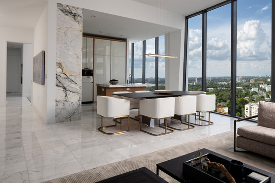 Miami Apartment looking from Living Room to Kitchen with floor to ceiling windows.