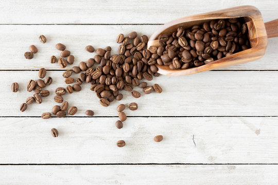 Loose Coffee Beans with Wooden Scoop