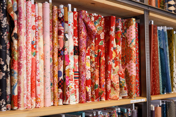 Cloth rolls on store shelves