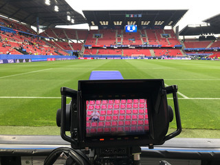 A TV camera monitor shows a fan sitting in the stands hours before the Japan-Holland match during the Women's World Cup soccer tournament in Rennes