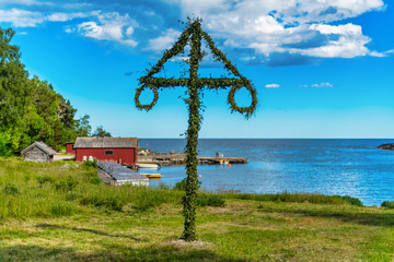 Classic midsommer pole at the coast line of Roslagen