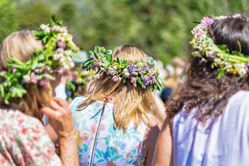 Midsummer with women wearing wraths during a clear and sunny day in Sweden
