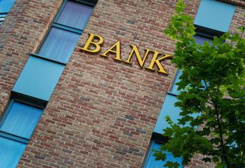 Bank word on brick wall - fototapety na wymiar