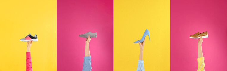 Wall Mural - Woman holding sportive shoe on yellow background, closeup. Space for text
