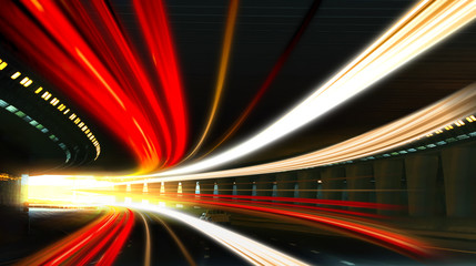 Modern cars driving through illuminated highway tunnel Fotomurales