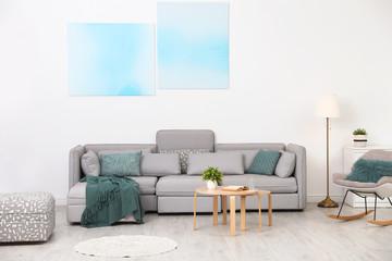 Fototapeta Modern living room interior with comfortable sofa obraz