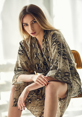 Fashion photo of blond woman wear fashionable dress