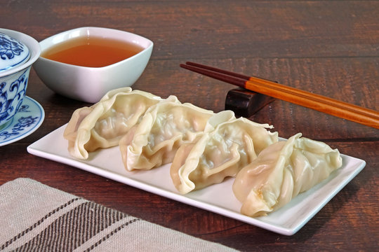 Dumpling : Chinese / Japanese dumplings, delicious traditional asian food. Japanese dumpling or Gyoza, Chinese dumpings or Jiaozi. Selective focus with copy space.