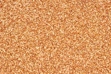 Orange decorative sequins. Background image with shiny bokeh lights from small elements