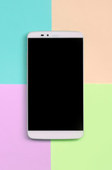 Modern smartphone with black screen on texture background of fashion pastel pink, blue, coral and...