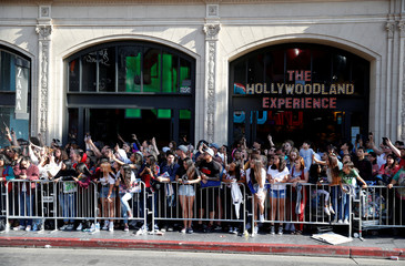 """Fans line up along a closed Hollywood Blvd. across from the TCL Chinese Theatre during the World Premiere of Marvel Studios' """"Spider-man: Far From Home"""" in Los Angeles, California"""