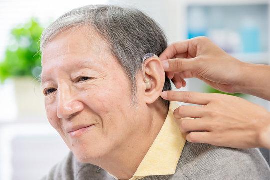 Doctor help patient wear audiphone
