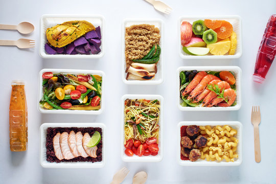 Prepared meal delivery concept. Top view of assorted ready-to-eat dishes over white background. Healthy eating.