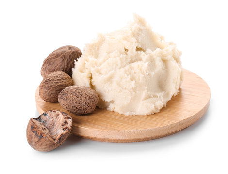 Board with shea butter on white background