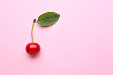 Tasty ripe cherry on color background Wall mural