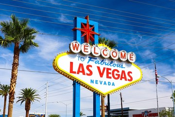 Fotobehang Las Vegas The Welcome to Fabulous Las Vegas sign on bright sunny day in Las Vegas.Welcome to Never Sleep city Las Vegas, Nevada Sign with the heart of Las Vegas scene in the background.
