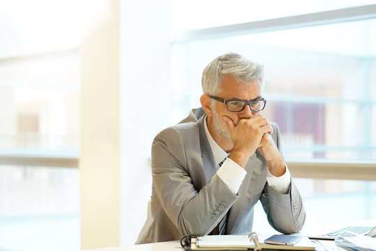 Stressed out businessman sitting at desk