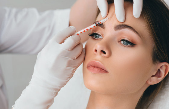 beauty injections into beautiful face. smoothing of mimic wrinkles around the eyes using biorevitalization