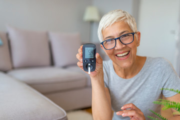 Concerned senior women doing blood sugar test at home. Lancet testing the blood glucose level of a person, diabetes. Diabetes concept and diabetes test