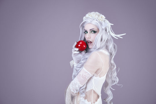 Young princess holding an apple in her hand