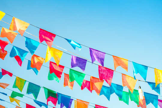 Typical colorful flags used for decoration at the June Festivals (aka festas de Sao Joao), with copy space (Oeiras, Brazil)