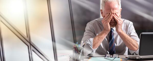 Portrait of tired businessman; multiple exposure