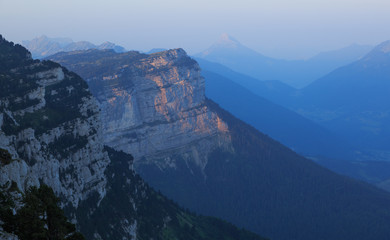 The limestone cliffs of the French Chartreuse mountainrange at dawn.