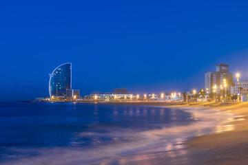 View of Barcelona Beach in summer night along seaside in Barcelona, Spain. Mediterranean Sea in Spain. Fototapete