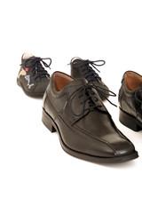 Symbolfoto mit Schuhen zum Thema Unternehmensnachfolge.