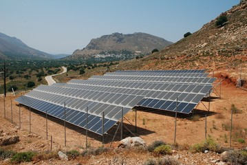 A bank of solar energy panels on the Greek island of Tilos on June 19, 2019. The island aims to become self sufficient in power through solar energy and a wind turbine.