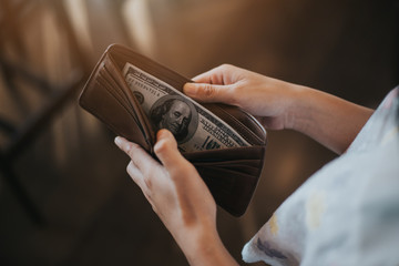 Unhappy bankrupt woman with empty wallet . Young woman shows her empty wallet. Bankruptcy
