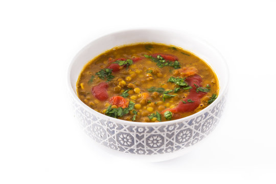 Indian lentil soup dal (dhal) in a bowl isolated on white background