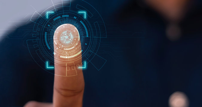 Businessmen scan fingerprints to access high-level information through the best security analysis of modern technology.
