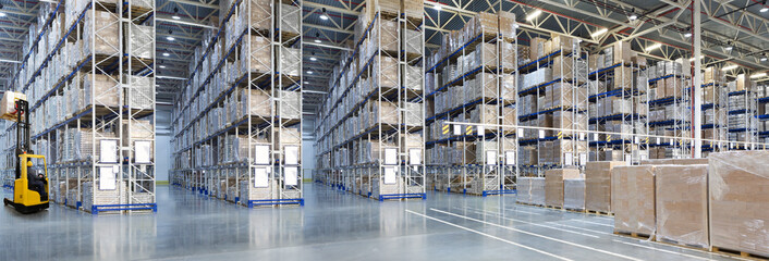 Huge distribution warehouse with high shelves and forklift Wall mural