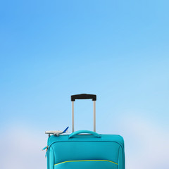 Fototapete - holidays. travel concept. blue suitcase and airplane toy infront of bokeh blue background