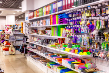 Department of sale of office supplies in the mall. Photo in blur.